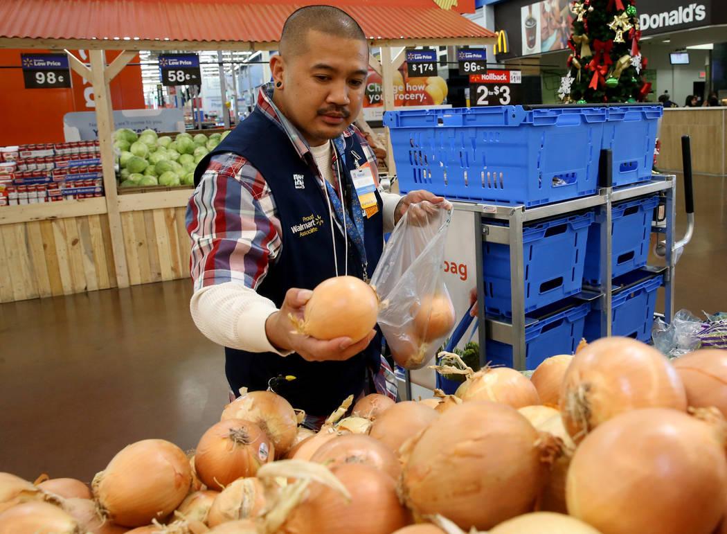 Personal shopper Melvin Oasay fills customer orders for pickup at Walmart at 7200 Arroyo Crossi ...