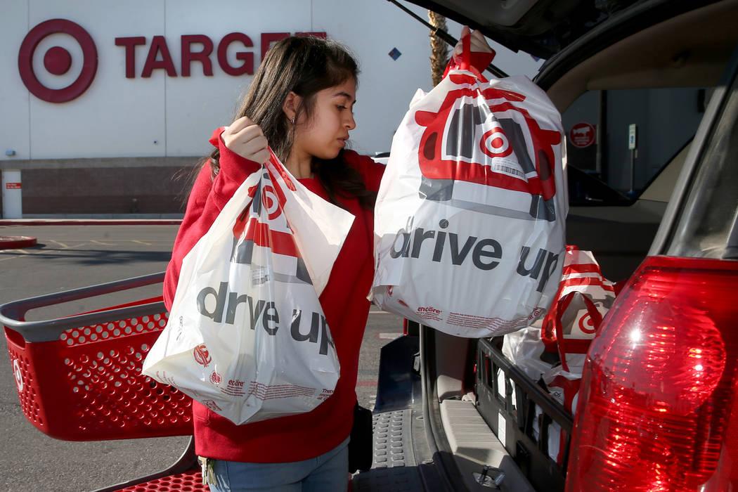 Guest service advocate Jessica De La Cruz delivers a curbside pickup order at Target at 9725 S. ...