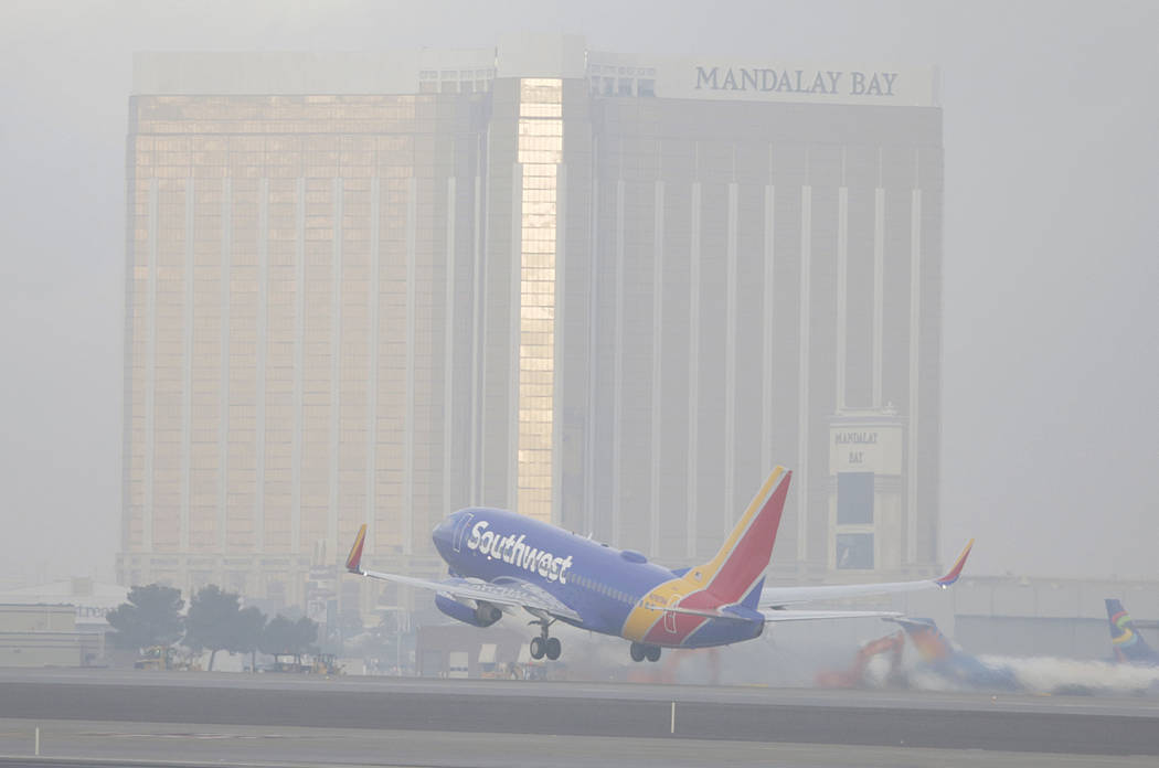 A Southwest Airlines jet takes off in dense fog at McCarran International Airport on Friday, De ...
