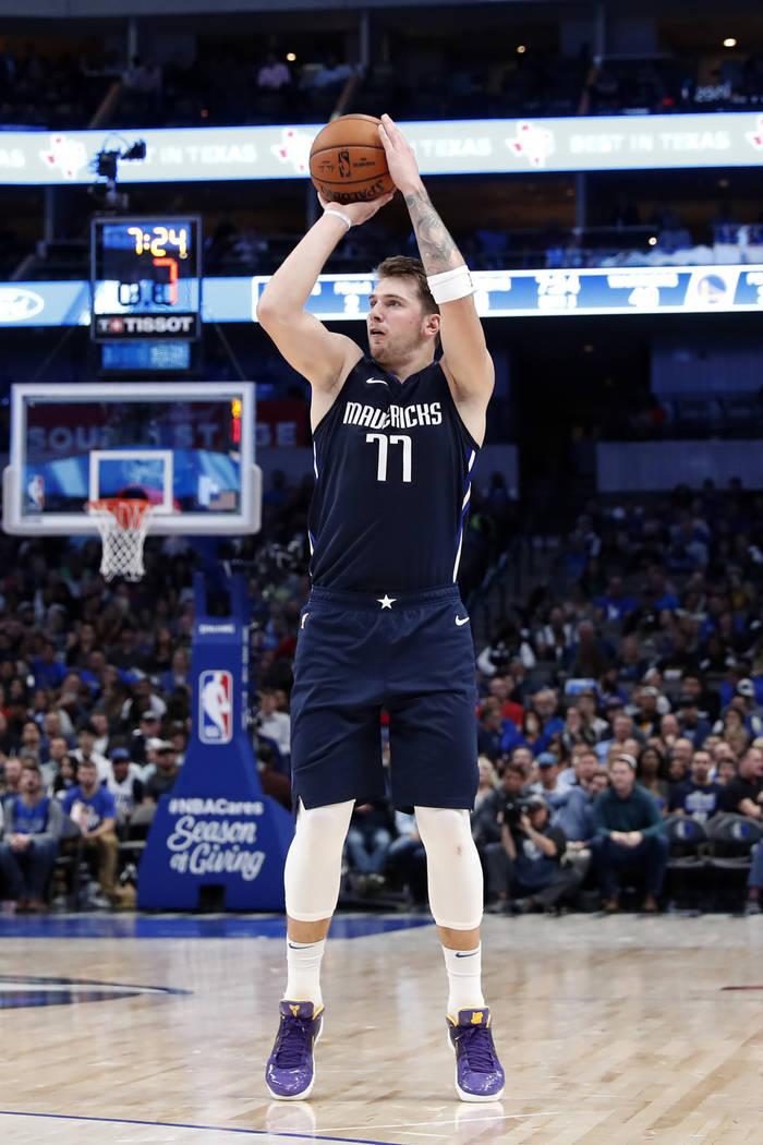 Dallas Mavericks forward Luka Doncic (77) takes a shot during an NBA basketball game against th ...