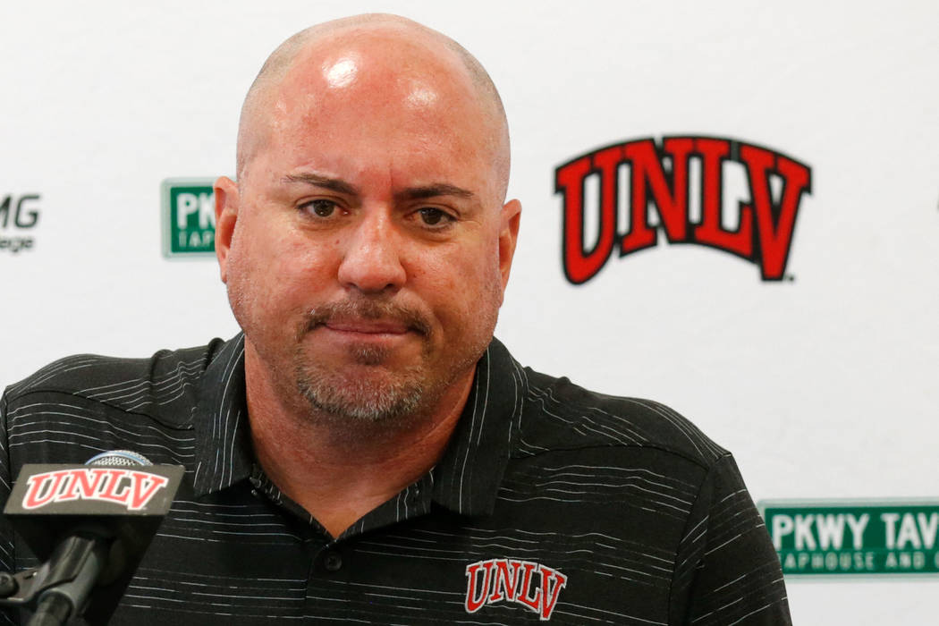 UNLV football head coach Tony Sanchez listens to a reporter's question during a news conference ...