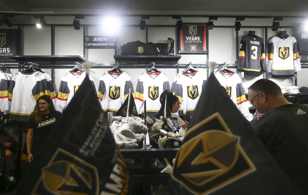 Golden Knights fans browse through merchandise at The Arsenal following a team practice at City ...