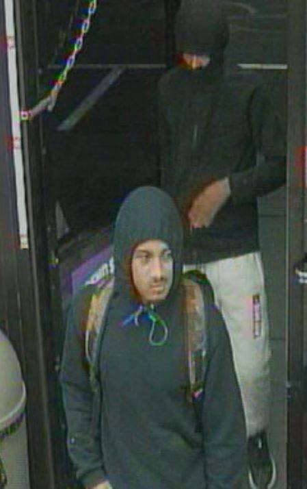 Two unidentified robbery suspects are pictured on video entering a business on North Rancho Bou ...