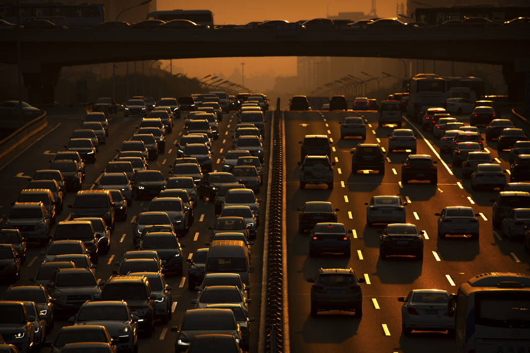 In a Friday, Sept. 6, 2019, file photo, commuters make their way along an expressway during rus ...