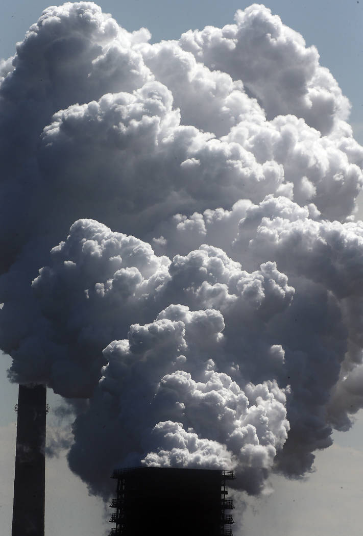 FILE - In this Monday, May 27, 2013 file photo, steam of a furnace pollutes the sky in Duisburg ...