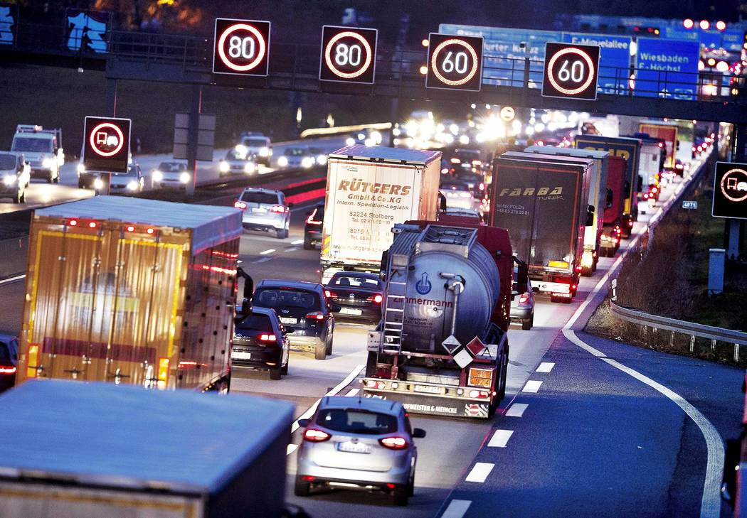 FILE - In this Tuesday, Dec. 4, 2018 file photo, Trucks line up on a highway in Frankfurt, Germ ...