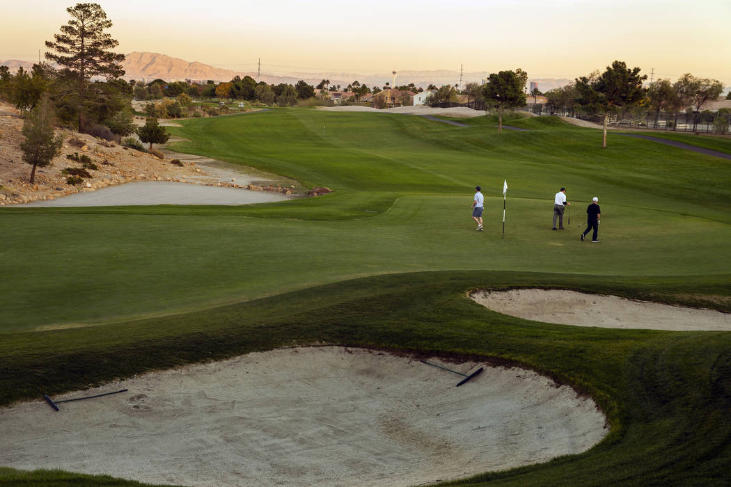 Golfers putt at hole # 18 on the Palm Course at the Angel Park Golf Club on Tuesday, Nov. 12, 2 ...