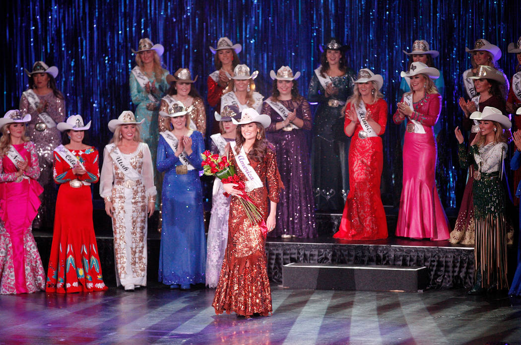 Miss Rodeo Mississippi Taylor McNair looks to the crowd after winning the Miss Rodeo America 20 ...
