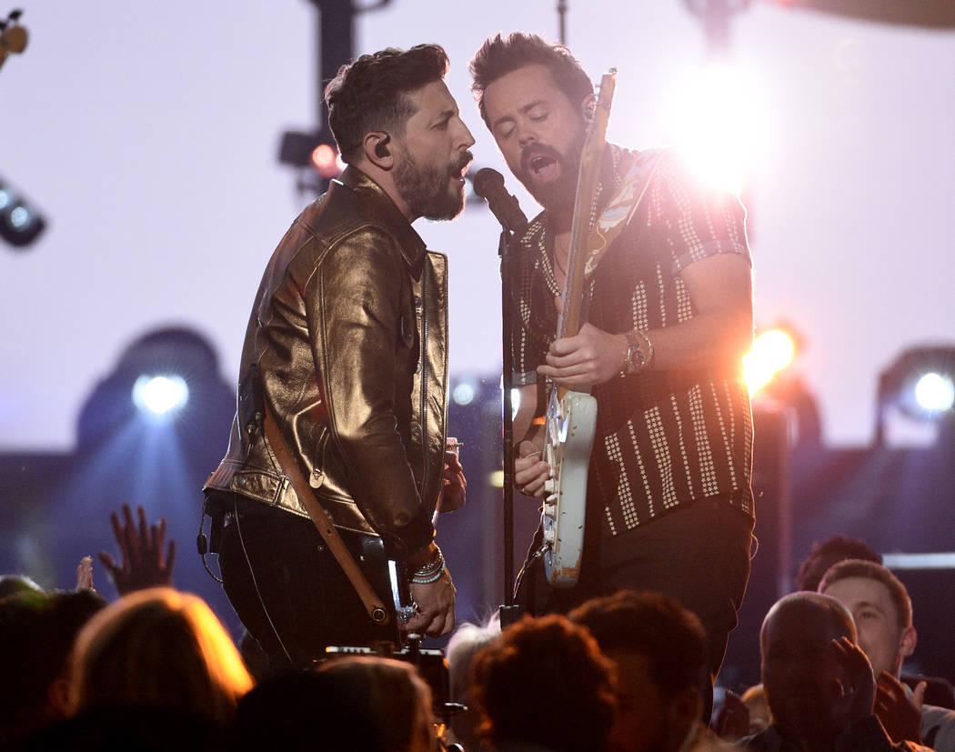 "Matthew Ramsey, left, and Brad Tursi, of Old Dominion, perform ""Make It Sweet"" at the ..."