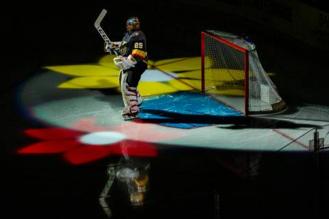 Vegas Golden Knights goaltender Marc-Andre Fleury (29) stands amongst flowers on the ice during ...