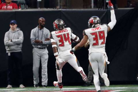 Tampa Bay Buccaneers safety Mike Edwards (34) runs into the end zone for a touchdown against th ...