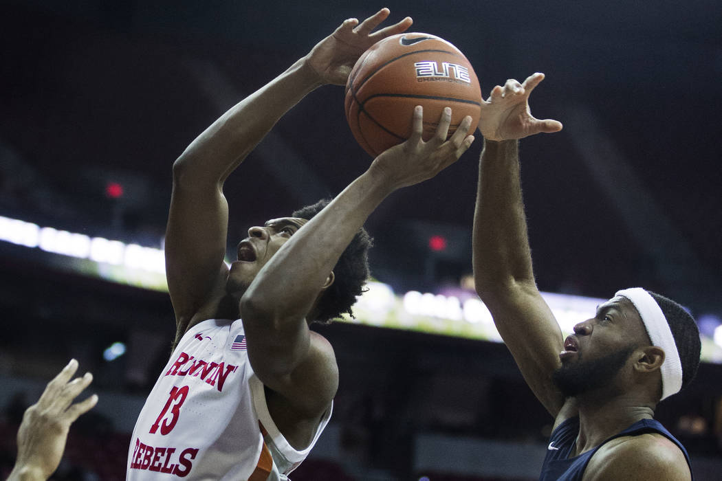 UNLV Rebels guard Bryce Hamilton (13) drives past Jackson State Tigers guard Lemmie Howard (21) ...