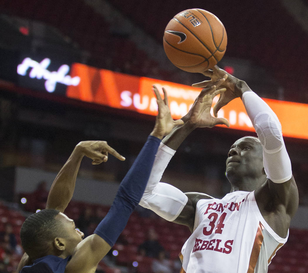 UNLV Rebels forward Cheikh Mbacke Diong (34) is fouled on the way to the rim by Jackson State T ...