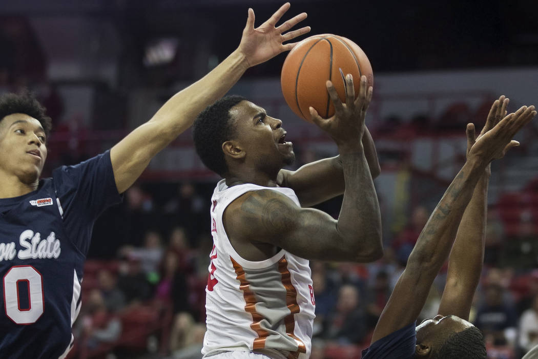 UNLV Rebels guard Amauri Hardy (3) drives past Jackson State Tigers guard Venjie Wallis (0) and ...