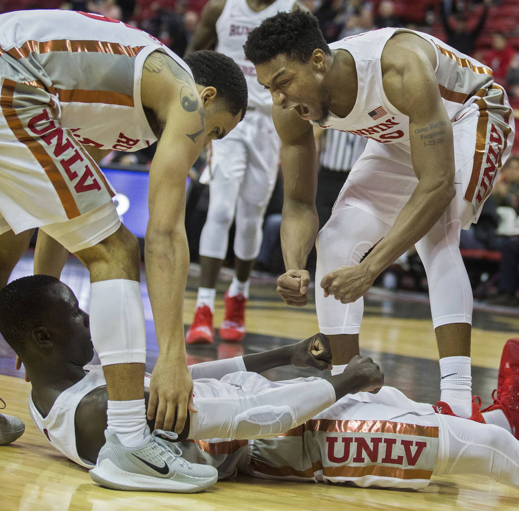 UNLV Rebels forward Nick Blair (20) celebrates with UNLV Rebels forward Cheikh Mbacke Diong (34 ...