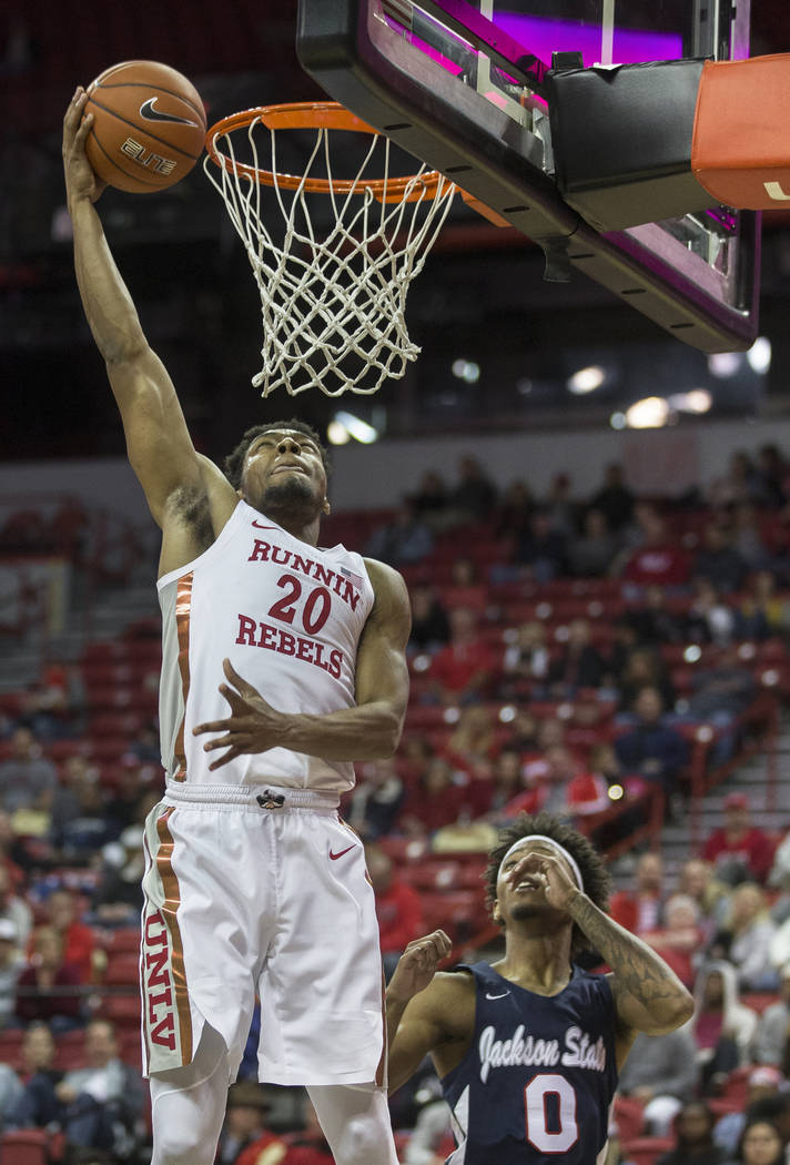 UNLV Rebels forward Nick Blair (20) drives baseline past Jackson State Tigers guard Venjie Wall ...