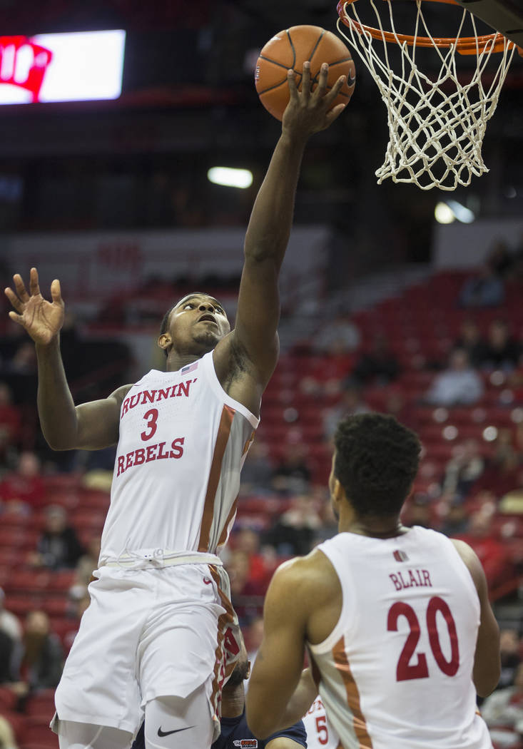 UNLV Rebels guard Amauri Hardy (3) slashes to the basket with UNLV Rebels forward Nick Blair (2 ...