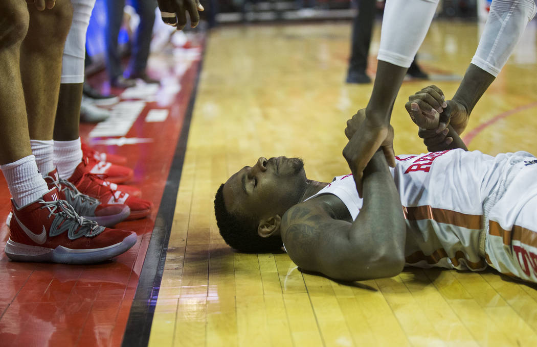 UNLV Rebels guard Amauri Hardy (3) is helped to his feet by a teammate in the second half durin ...
