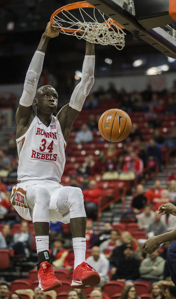 UNLV Rebels forward Cheikh Mbacke Diong (34) dunks in the second half during their NCAA basketb ...