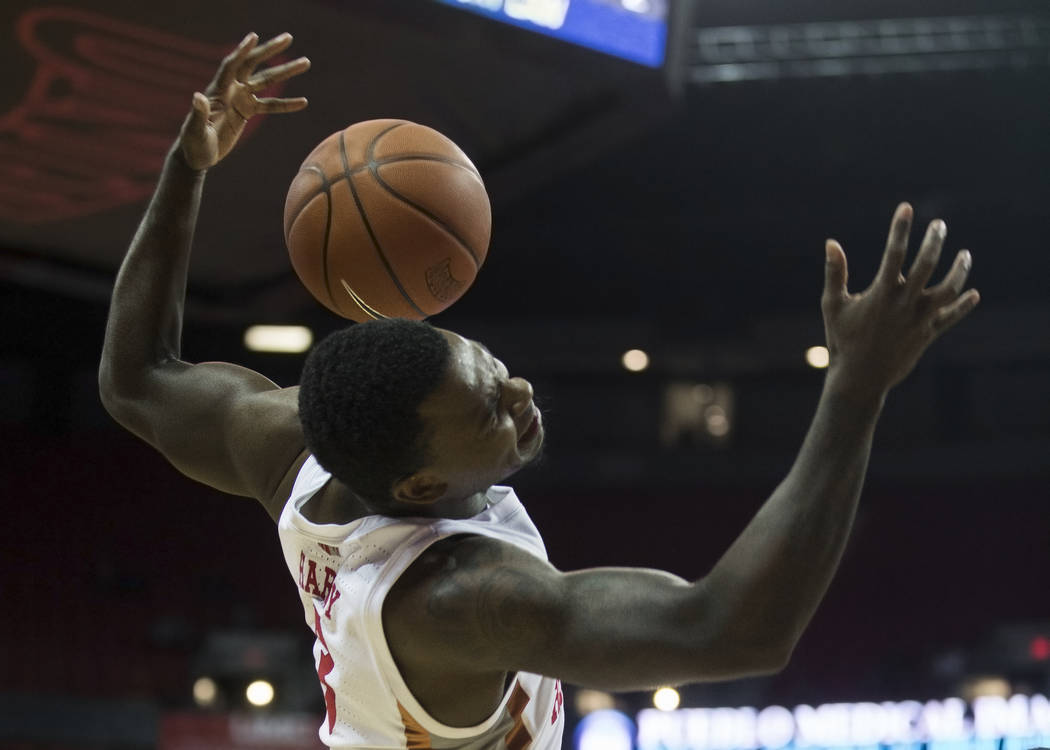UNLV Rebels guard Amauri Hardy (3) takes a hard foul in the second half during their NCAA baske ...
