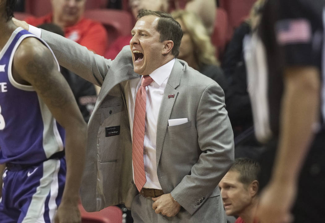 UNLV Rebels head coach T.J. Otzelberger directs his team during their NCAA basketball game with ...