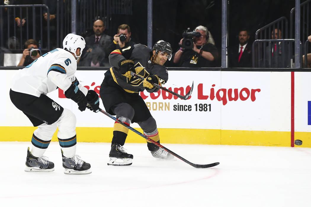 Golden Knights' Max Pacioretty (67) shoots the puck past San Jose Sharks' Dalton Prout (5) duri ...
