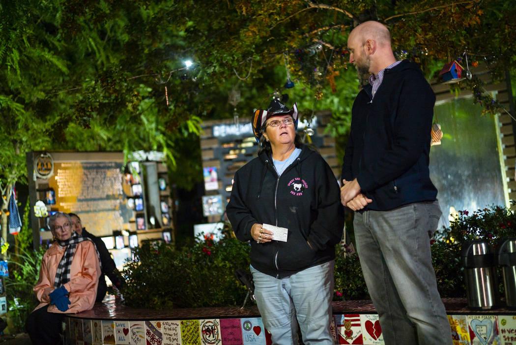 Oct. 1 survivor Sue Ann Cornwell, center, speaks alongside Aaron Leifheit, program director for ...
