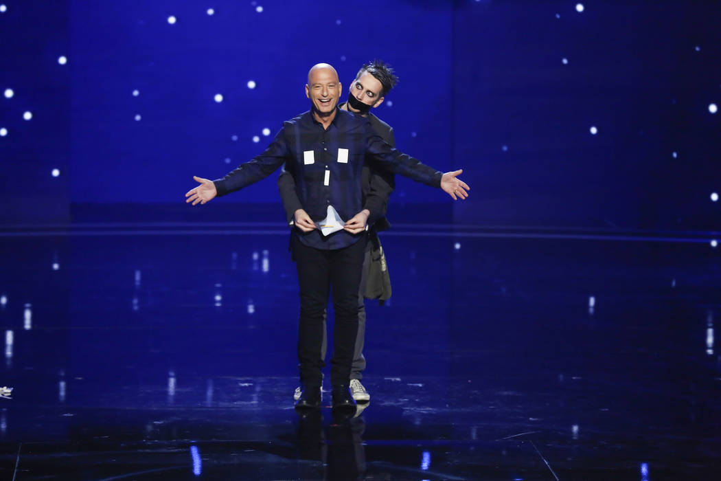 """Howie Mandel, left, and Sam Wills as Tape Face on """"America's Got Talent."""" (Vivian Zink/NBC)"""