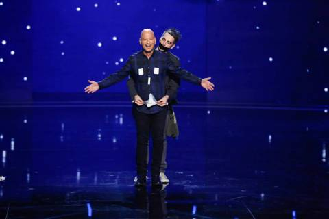"Howie Mandel, left, and Sam Wills as Tape Face on ""America's Got Talent."" (Vivian Zink/NBC)"
