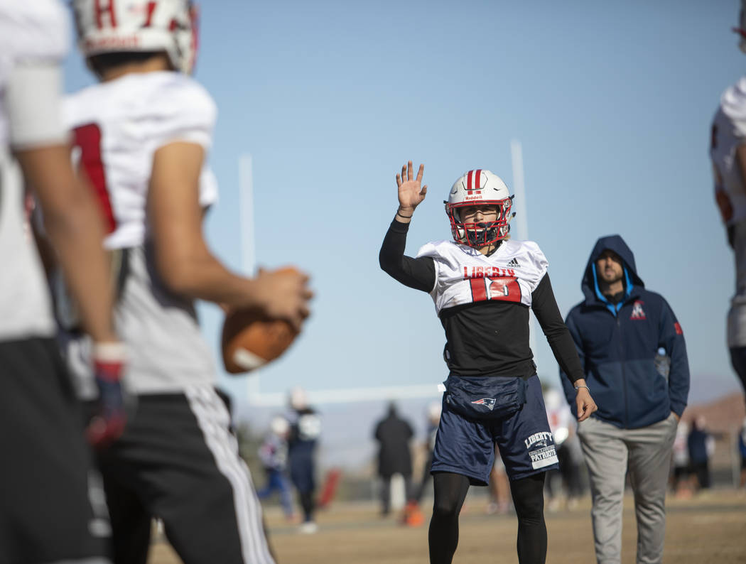 Liberty High School quarterback Daniel Britt (18) motions for the ball during practice on Tuesd ...