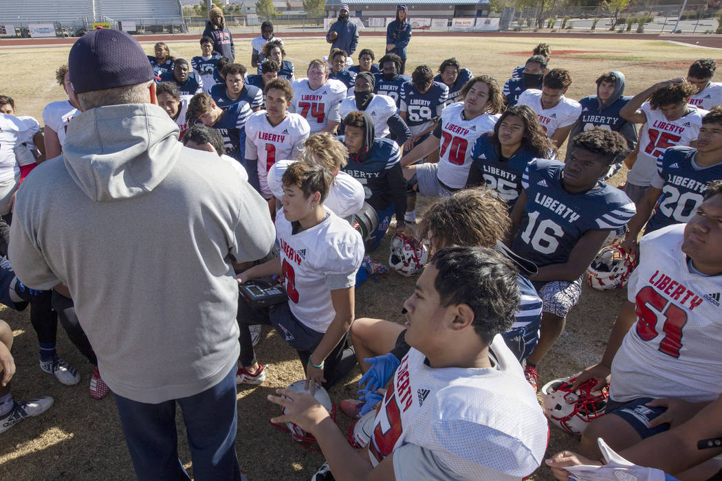 Liberty High School head coach Rich Muraco gathers the team as their practice comes to an end o ...