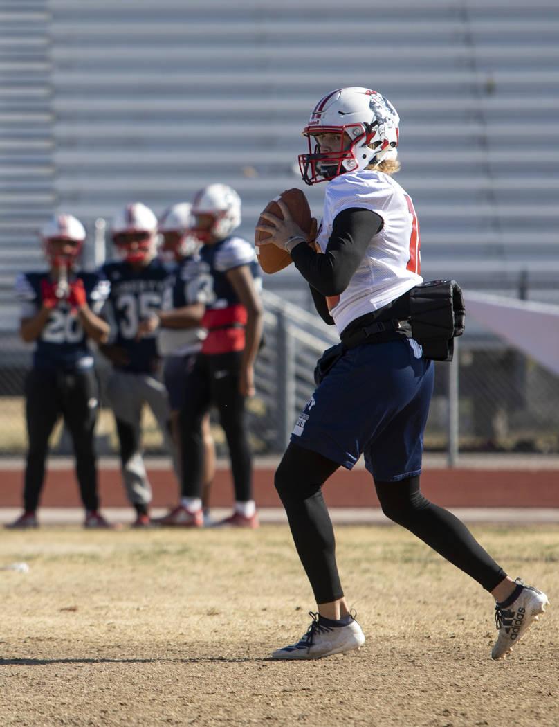 Liberty High School quarterback Daniel Britt (18) eyes to pass the ball during practice on Tues ...
