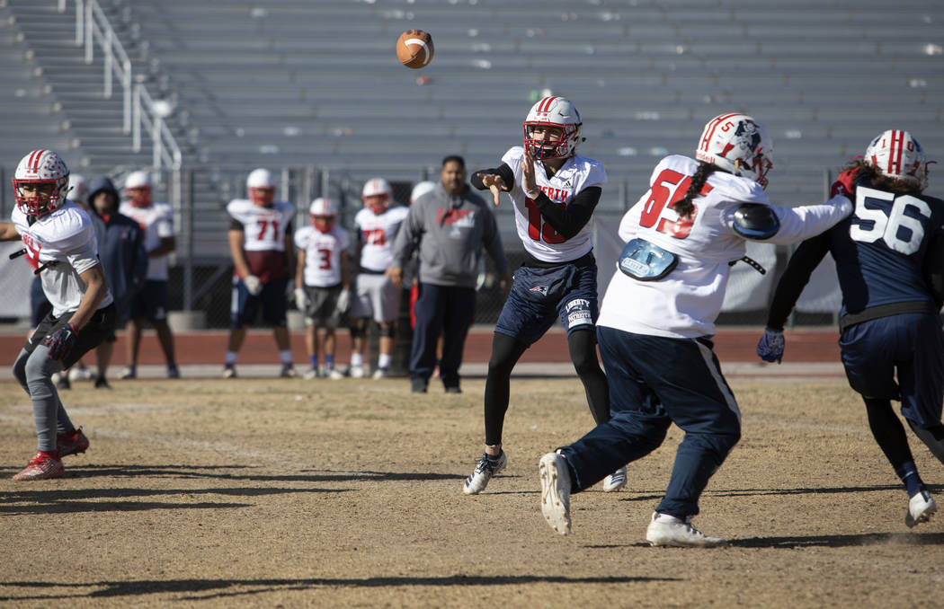Liberty's quarterback Daniel Britt (18) throws the ball during a drill at practice on Tuesday, ...