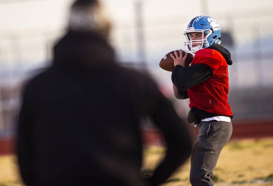 Centennial quarterback Colton Tenney looks to throw the ball during football practice at Centen ...