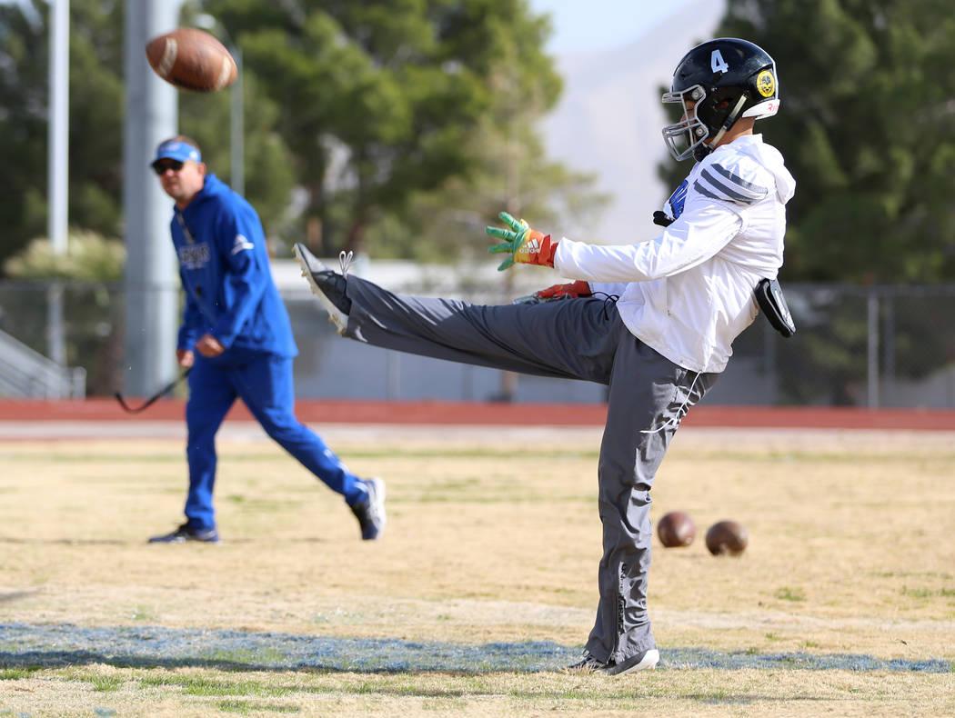 Desert Pines' Branden Thomas (4) punts the ball during a team practice at Desert Pines High Sch ...