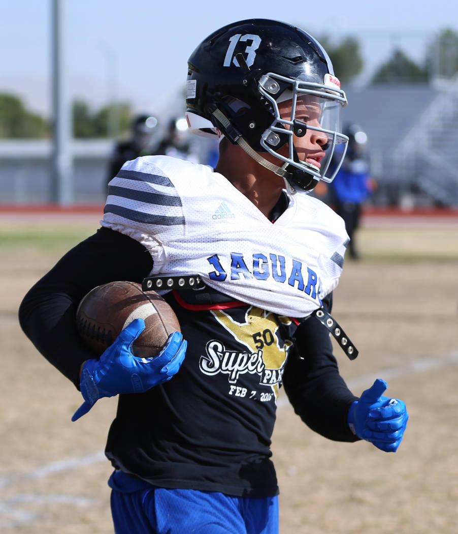 Desert Pines' Michael Jackson (13) returns a punt during a team practice at Desert Pines High S ...