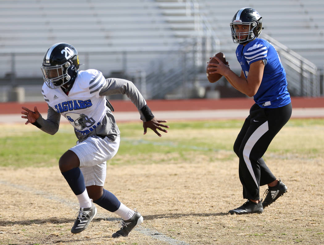 Desert Pines' Rjay Tagataese (15) looks to make a pass to DeAvonte McGee (20) during a team pra ...