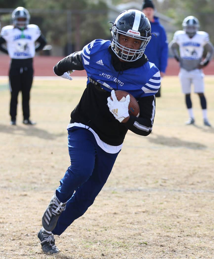 Desert Pines' Malik Brooks (10) runs the ball during a team practice at Desert Pines High Schoo ...
