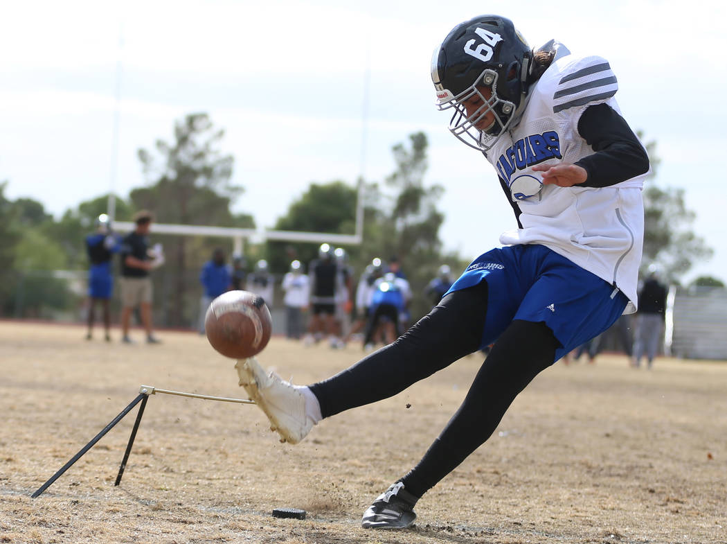 Desert Pines' Luis Magana (64) kicks a field goal during a team practice at Desert Pines High S ...