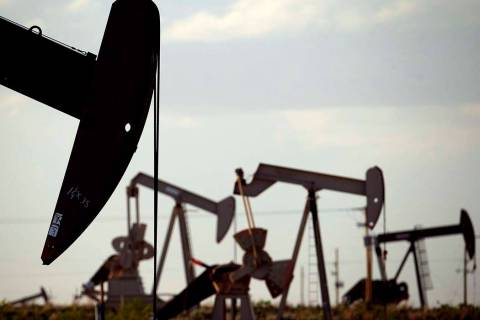 In an April 24, 2015, file photo, pumpjacks work in a field near Lovington, N.M. Oil industry ...