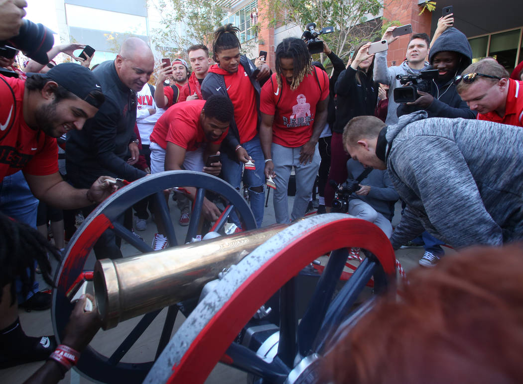 UNLV students and officials watch as UNLV's football players, including kicker Evan Pantels, ri ...