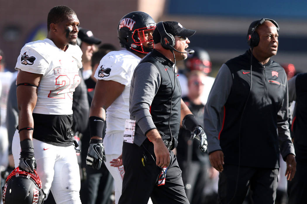 UNLV Rebels defensive line coach Tony Samuel, right, and head coach Tony Sanchez coach from the ...