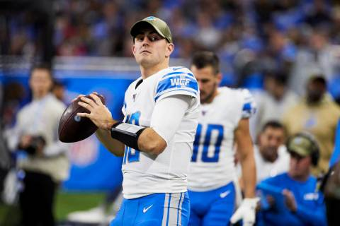 Detroit Lions quarterback David Blough (10) warms up against the Dallas Cowboys during an NFL f ...