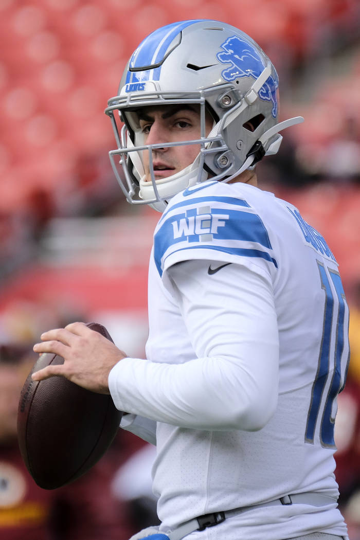 Detroit Lions quarterback David Blough warms up prior to an NFL football game between the Detro ...