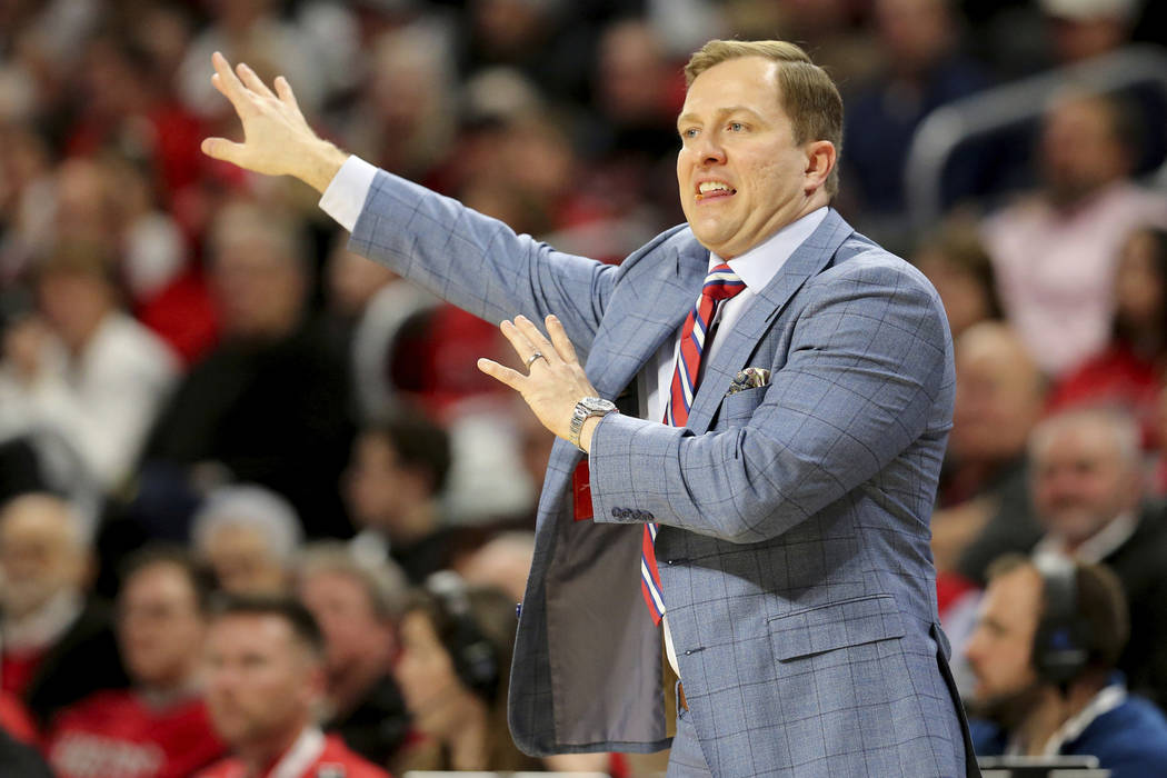 UNLV coach T.J. Otzelberger gestures during the first half of the team's NCAA college basketbal ...