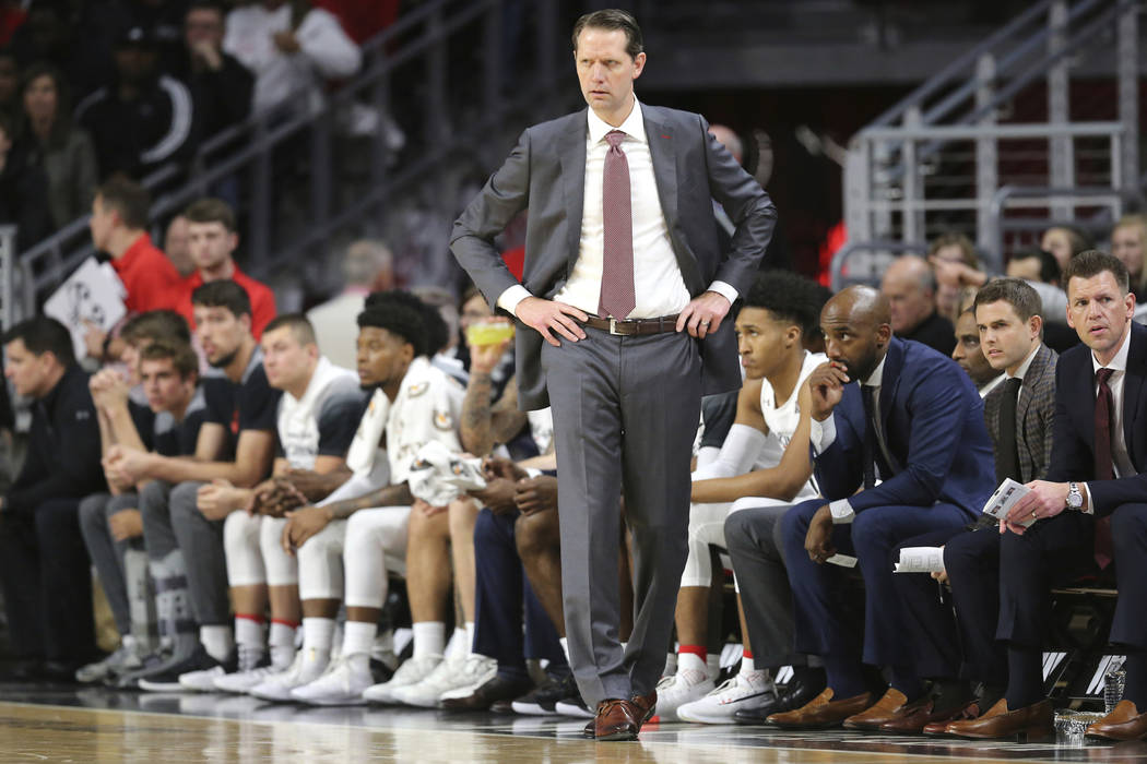 Cincinnati coach John Brannen paces the sideline during the first half against UNLV in an NCAA ...