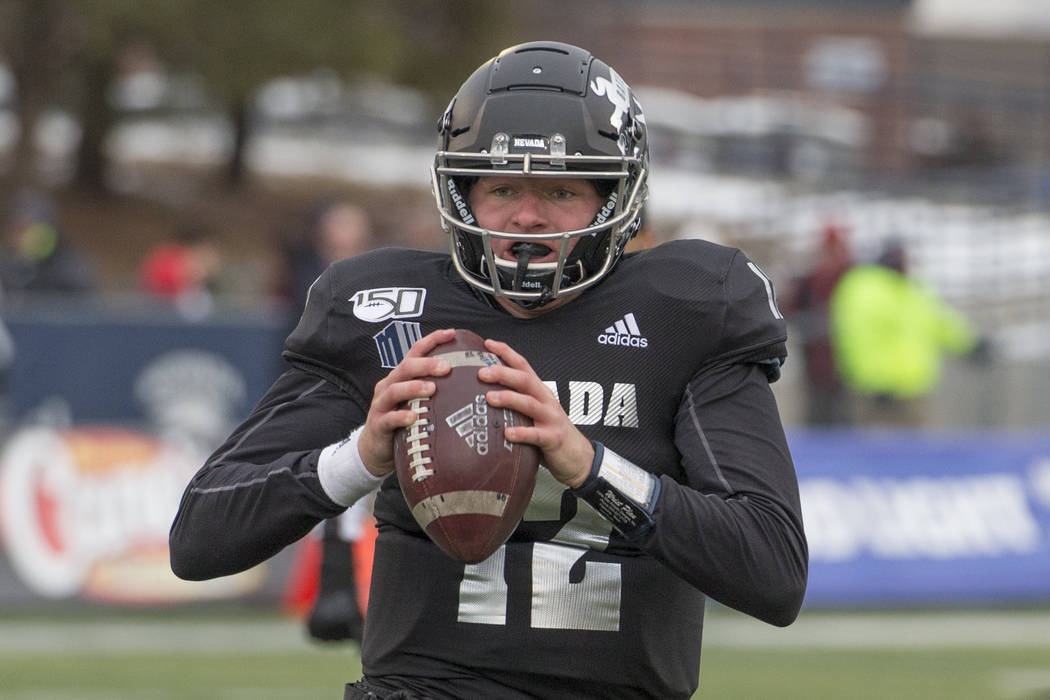 Nevada quarterback Carson Strong (12) looks to throw against UNLV second half of an NCAA colleg ...
