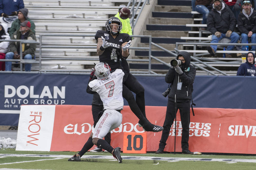 Nevada wide receiver wide receiver Elijah Cooks (4) goes up for a pass as UNLV defensive back J ...