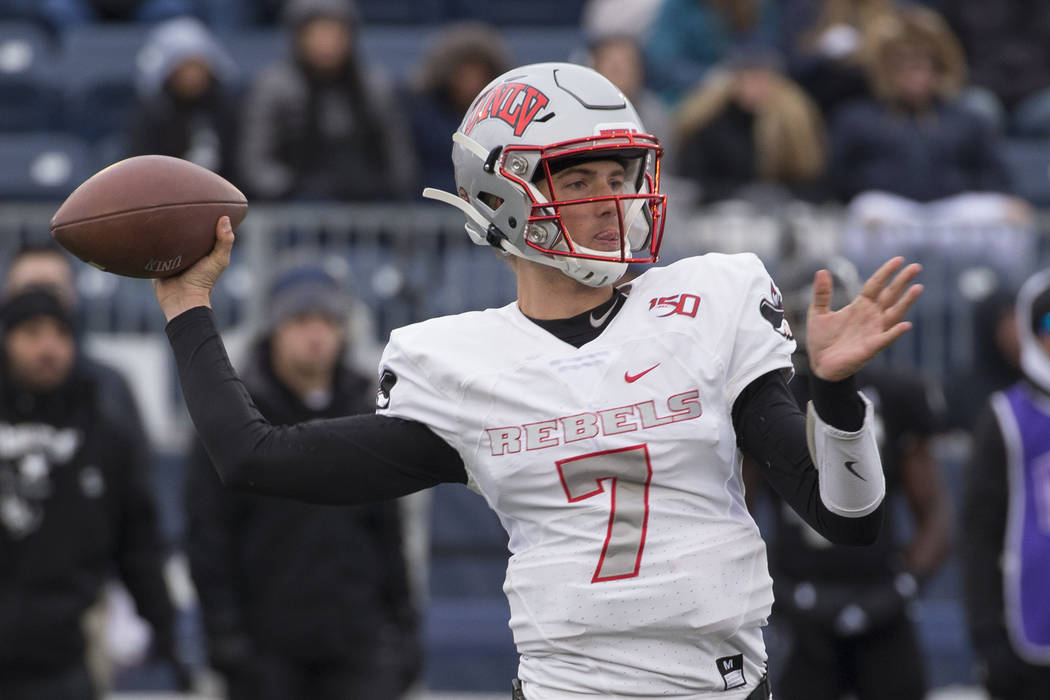 UNLV quarterback Kenyon Oblad (7) throw against Nevada in the second half of an NCAA college fo ...