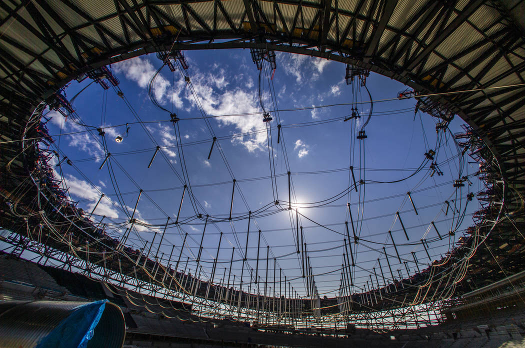 Steel cables are in place to raise the roof during a tour of the Raiders Allegiant Stadium cons ...